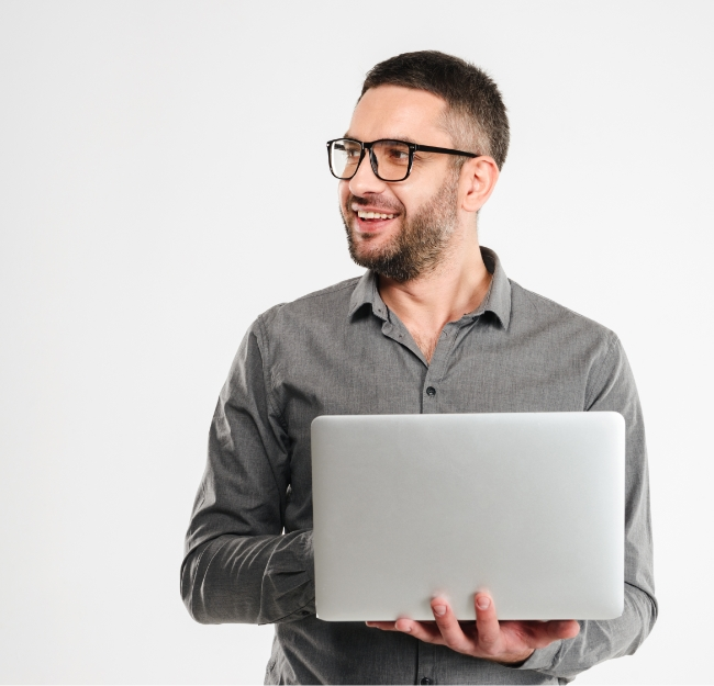 concentrated-businessman-using-laptop-computer-PE3ARHB.jpg